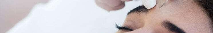 botox needle in woman's forehead